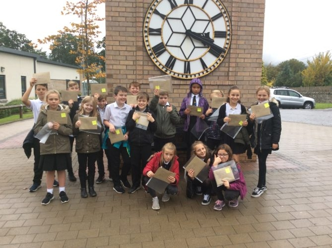 The class deliver their letters to local businesses