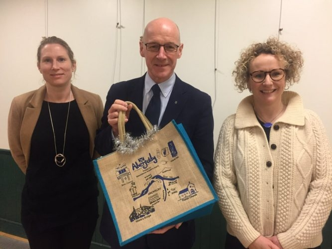 Deputy First Minister, John Swinney being presented with his very own Birks Bag Company bag from the Parent Council